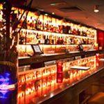 Laska Bar Guernsey - shelving LEDs create a striking highlight effect