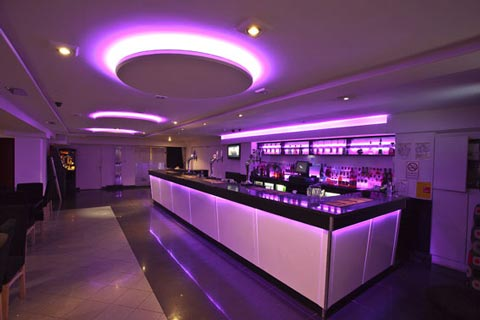 7.2 Watt 5050 SMD RGB LED strips lit up purple in a restaurant
