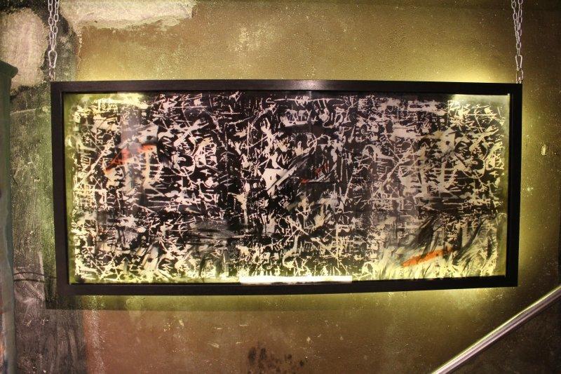Shallow lightbox illuminates art by Carole Waller