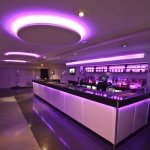 7.2 watt (5050 SMD) RGB LED tape lit up purple in a restaurant