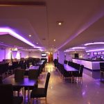 7.2 Watt 5050 SMD RGB LED Tape lit up purple in a bar