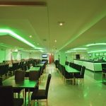 7.2 Watt 5050 SMD RGB LED Tape lit up green in a restaurant