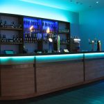 RGB LEDs mixing sea-green light on bowling alley bar