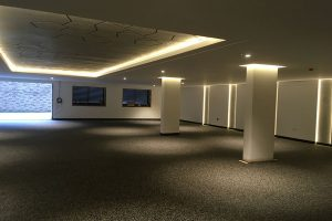 Warm-white 10W LED strips creates pools of light in this residential parking area