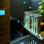 Bannister-rail lit by LED step lights