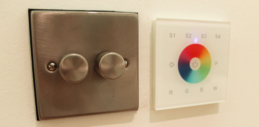Single-zone LED wall controller beside traditional a traditional dimmer