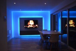 TV room media panel and kitchen lit by RGBW LEDs