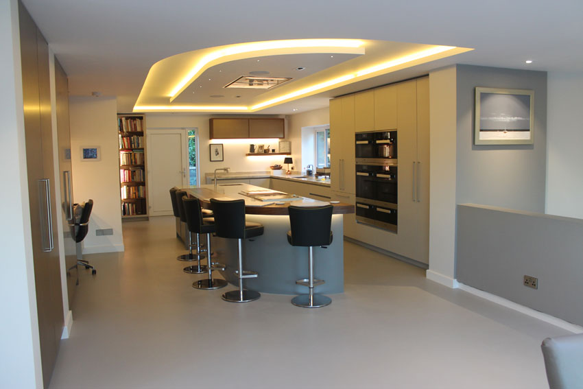 Kitchen breakfast bar under cut-out-ceiling feature LEDs