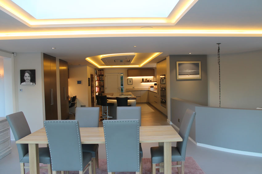 Dining-table looking through to kitchen with LED feature-lights