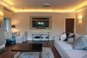 Coving LED tape lights this wall-mounted TV