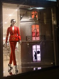 Three small lightboxes in Dior's Christmas shopwindow