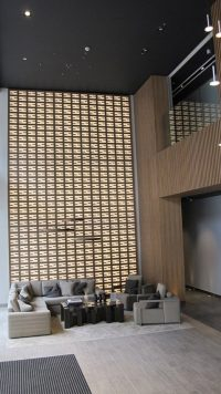 LED lightbox panels in the lobby of an apartment block