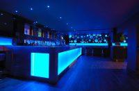 Nightclub back bar with LED lightbox panel