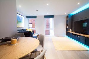 Living room RGBW LED media-panel highlights set to pastel blue