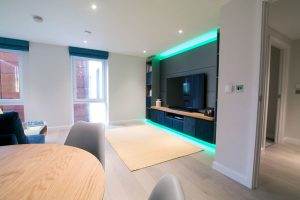 Living room RGBW LED media-panel highlights set to pastel green