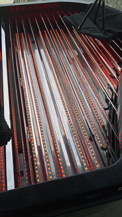 Fitting the LED strips in rows within the custom-built piano case