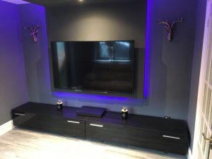 The finished cinema room, with TV media panel - view 1