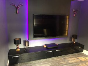 The finished cinema room, with TV media panel - view 2