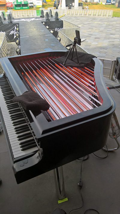 Setting up the piano on tour