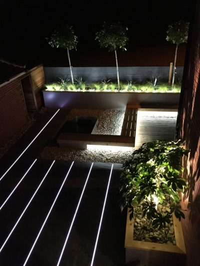 Cool-white LED strips create a contemporary patio