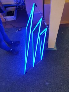 10-watt blue LED strips being fitted to the triangular frames